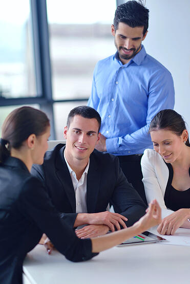 Group of happy young  business people in a meeting at office-1