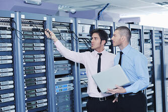 group of young business people it engineer in network server room solving problems and give help and support-1